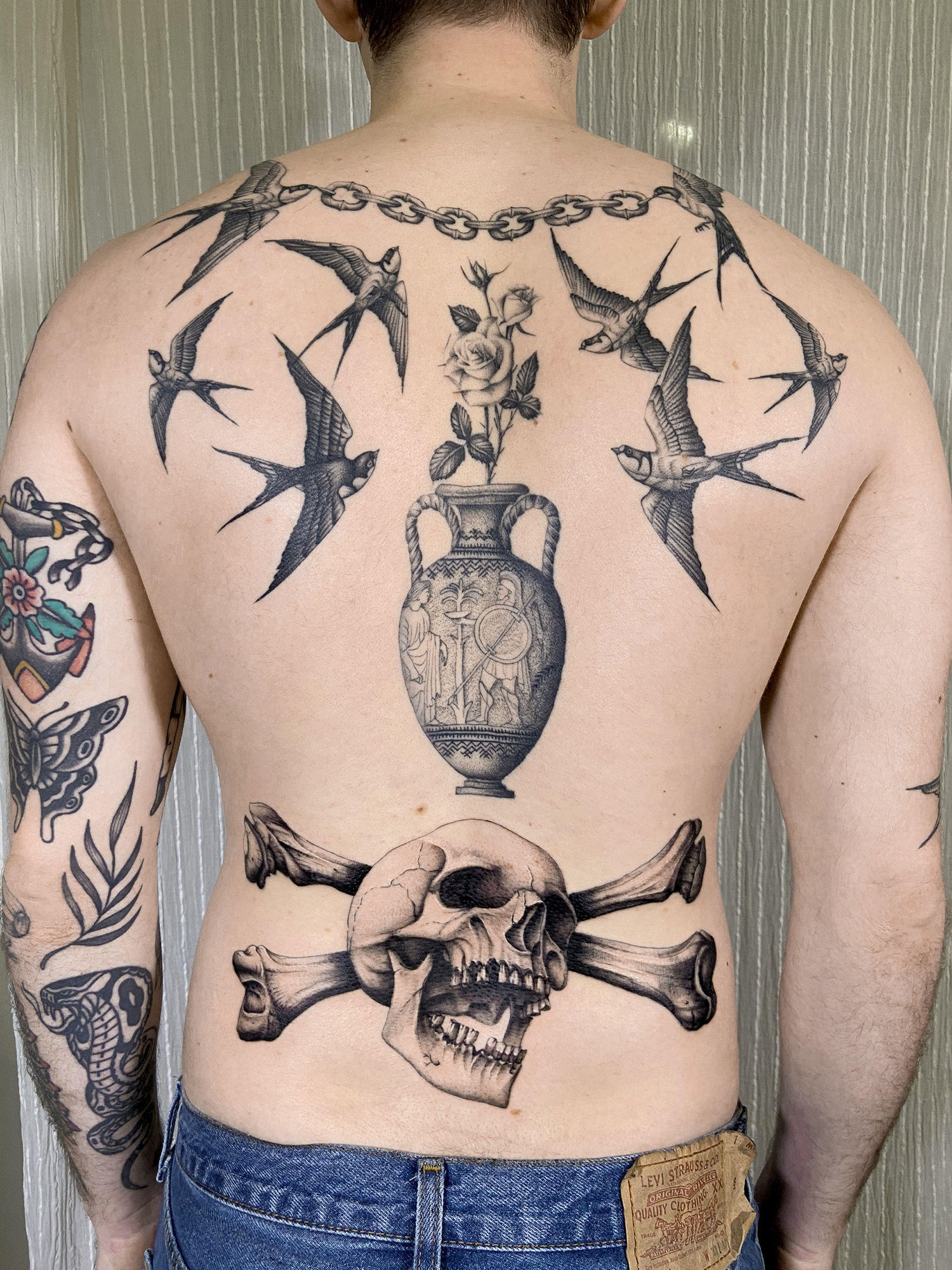 swallow fine-line tattoos on back, sang bleu london, skull tattoo