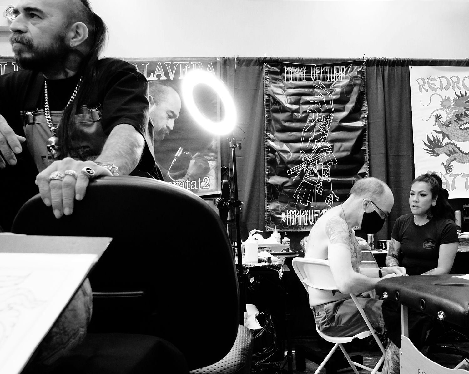 right: tattooist Byron Rodriguez El Calavera at feather falls, oroville, california, tattoo convention