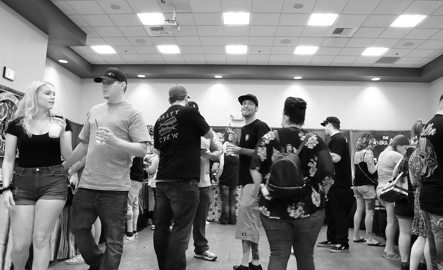 Spectators at the 5th annual feather falls tattoo expo