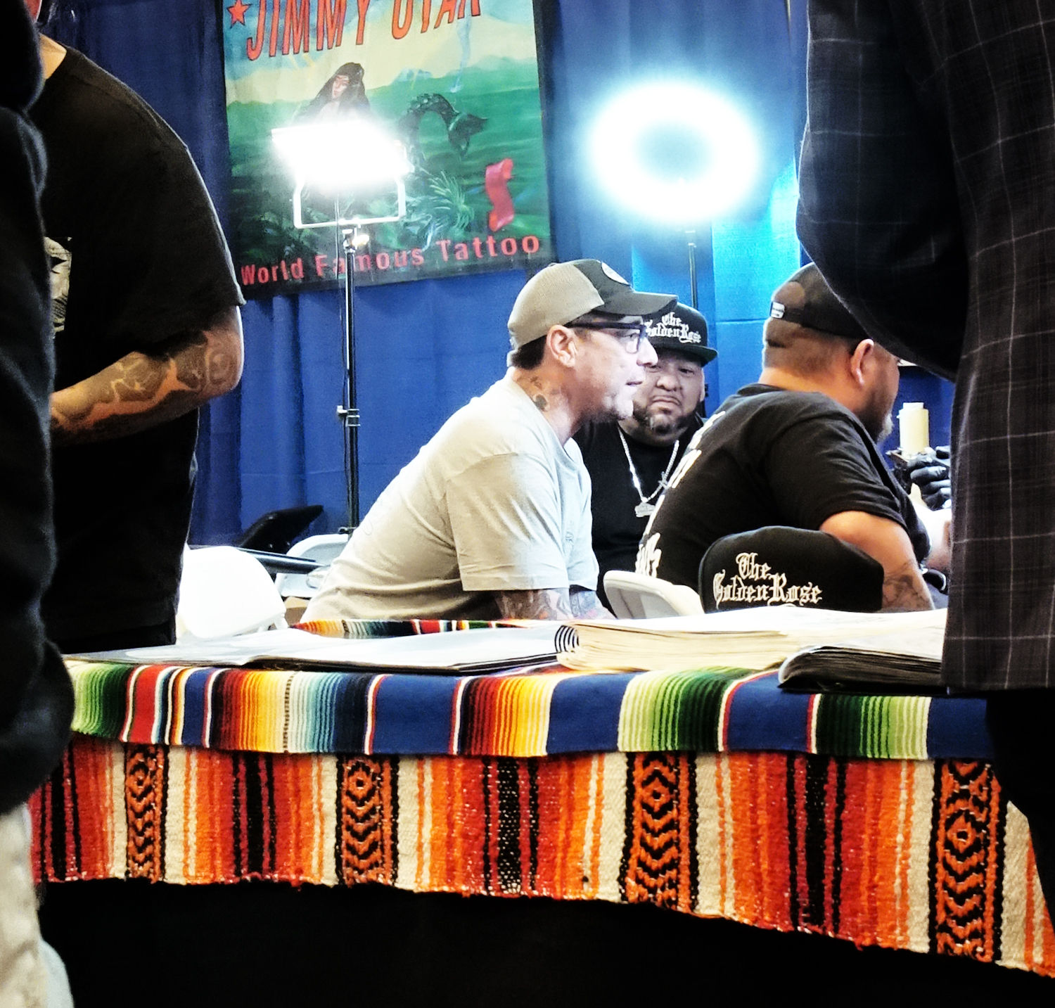 Feather Falls tattoo expo organizer Chris Earl talking to members of Modesto's The Golden Rose tattoo shop