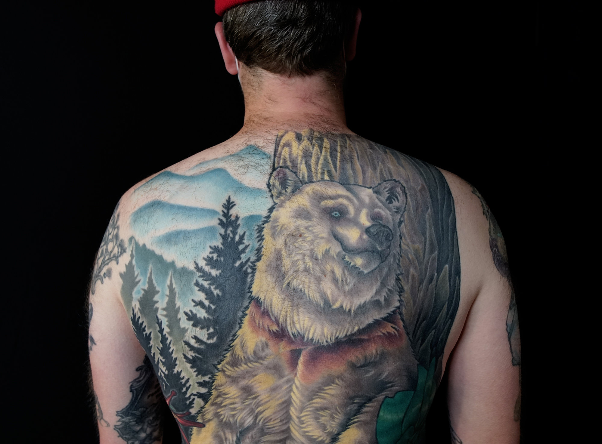 Back color tattoo, nature theme with big bear and plants by hannah wolf