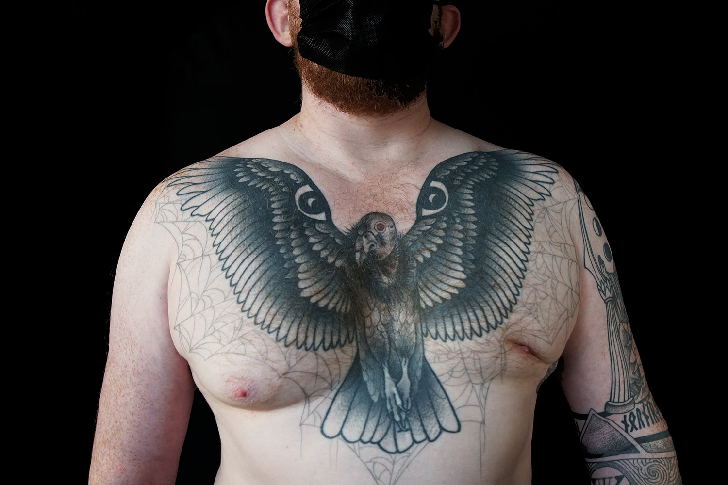 Along with the large bird on the chest, the client requested that it be surrounded by subtle spider webs.