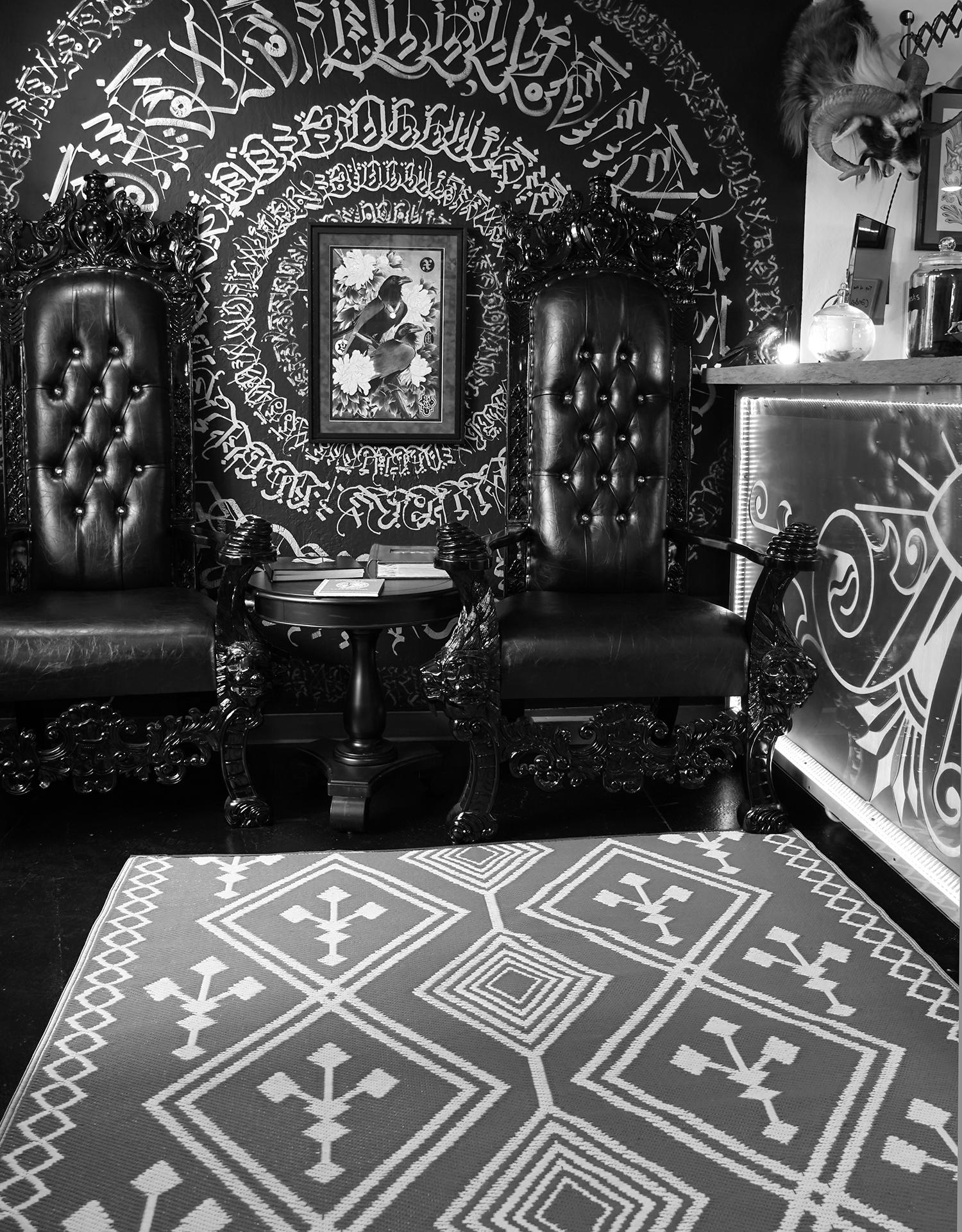 oakland's old crow studio entrance, with abstract calligraphy and leather chairs
