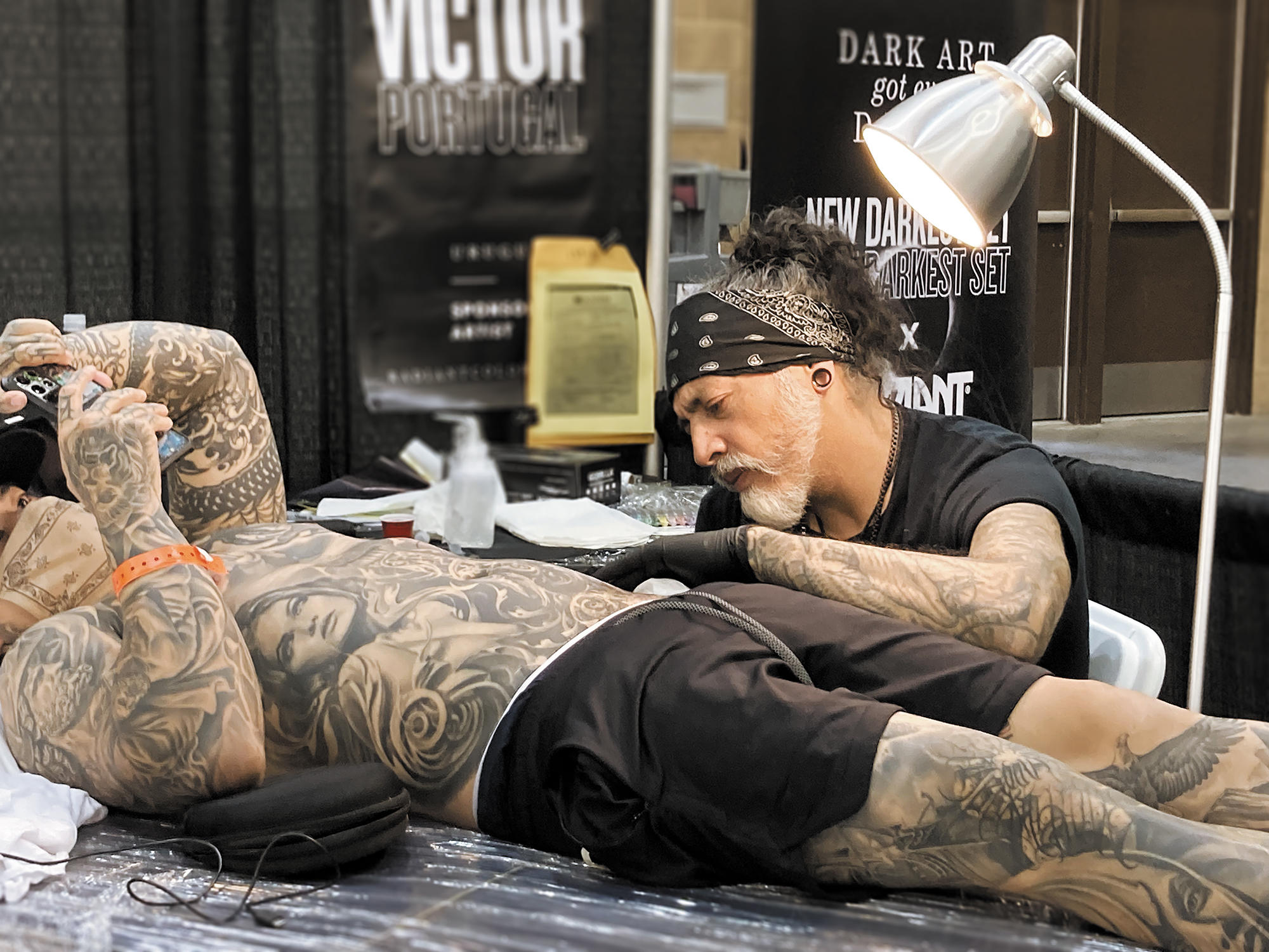 Victor Portugal working on bodysuit at the Golden State Tattoo expo