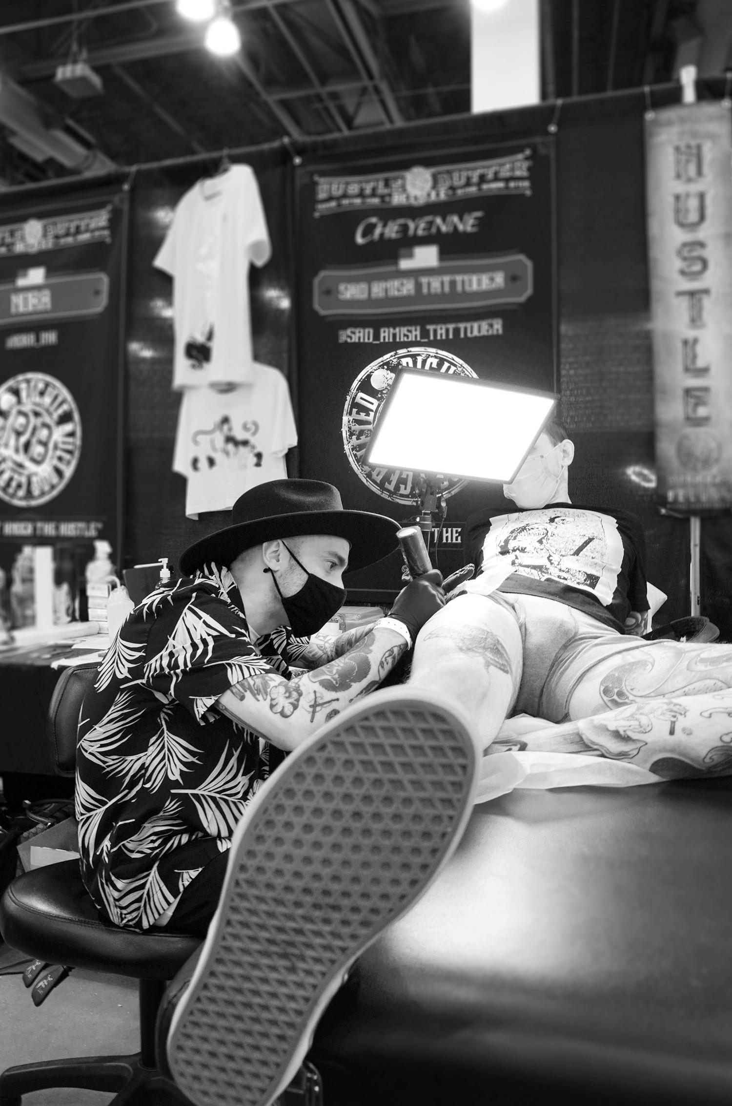 LA-based tattooist Sad Amish displays erotic art at the expo.