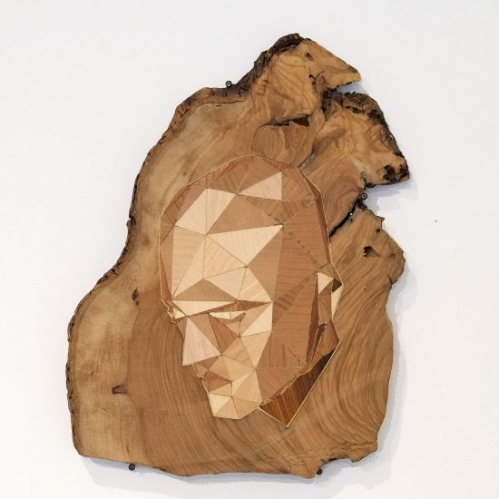 A Computerized Man Emerges from Wood Logs