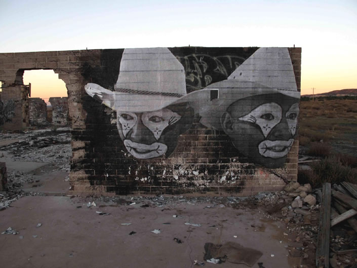 Large Images wheatpasted in the Navajo Nation