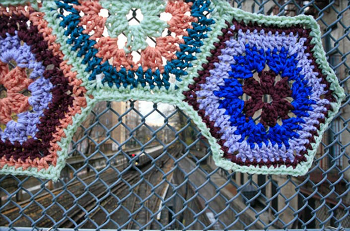 Invasive Crochet on Fences and Barbed Wire