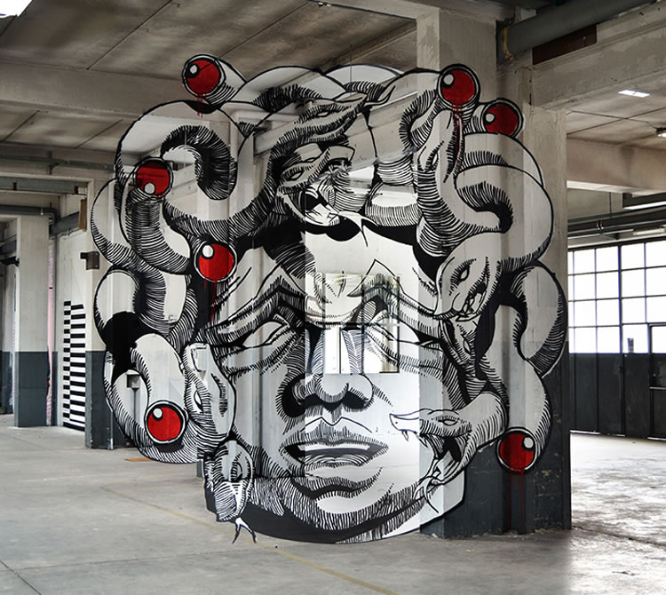 An Anamorphic Medusa Painted Inside a Factory